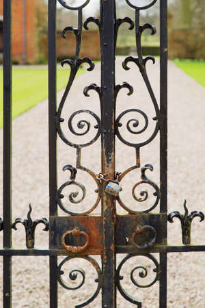 a locked gate with a chain photo
