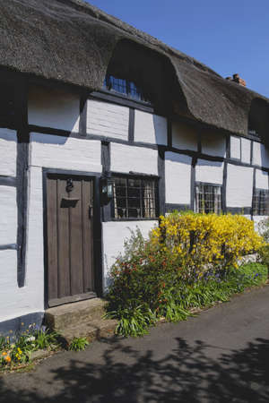 a cottage in an english village photo