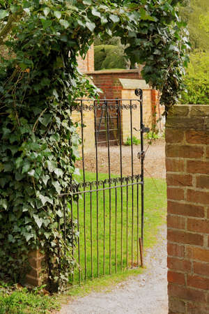 walled: gated entrance to old walled garden Stock Photo