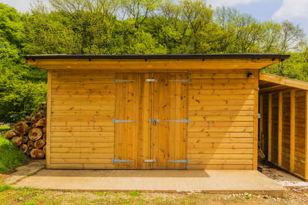 new wooden shed in a garden photo