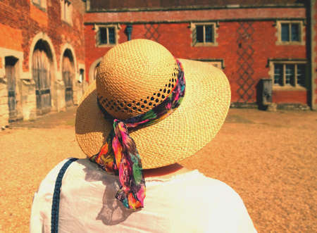 stately home: Woman in straw hat at stately home Stock Photo