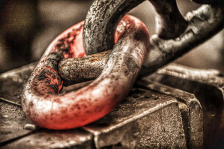 industrial: chain link being forged