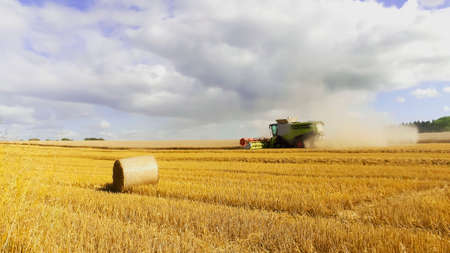 are combined: a combined harvester in a wheatfield Stock Photo