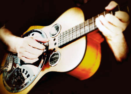 resonator: Guitarist playing dobro guitar