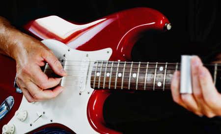 fender stratocaster: Guitarist playing vintage fender stratocaster guitar