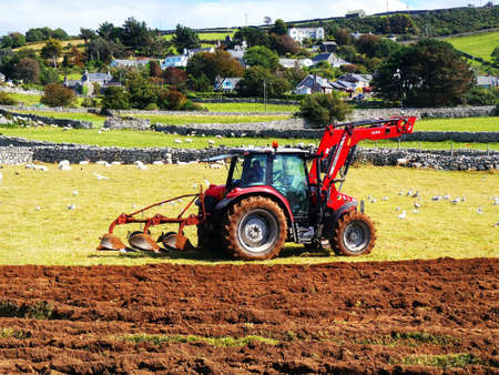 ploughing field: Tractor Stock Photo
