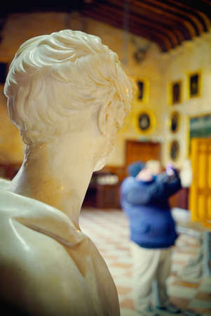 stately home: Statue looking at man taking photograph in stately home Stock Photo