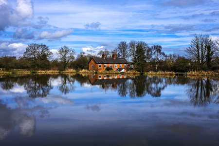 House by water Stock Photo