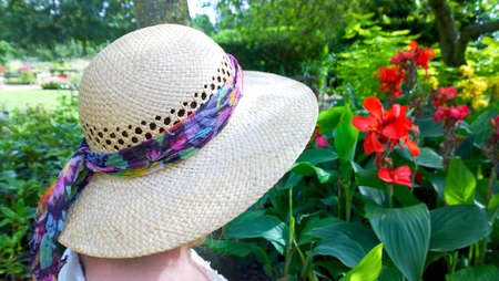 baby boomer: woman in garden with straw hat