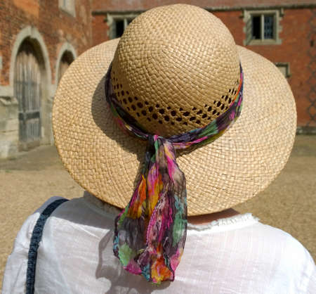 straw the hat: woman in garden with straw hat