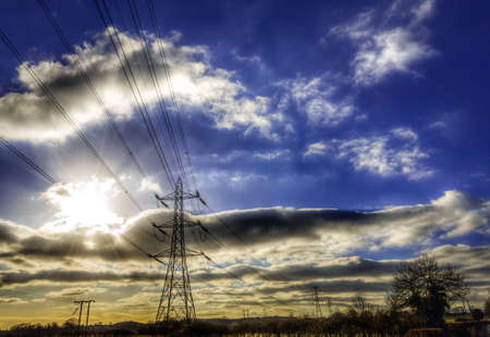 wire: Electricity pylons in the countryside Stock Photo