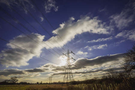 Electricity pylons in the countryside Stock Photo