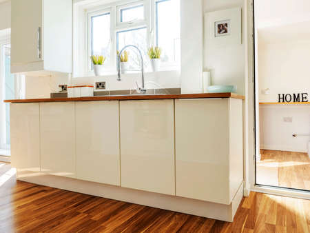 split level: colour image kitchen in newly restored rebuilt house work surfaces
