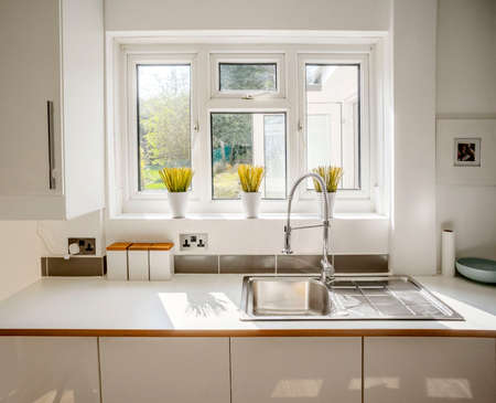 colour image kitchen in newly restored rebuilt house work surfaces Reklamní fotografie - 38614002