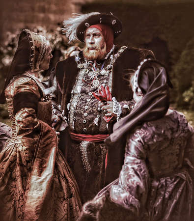 People in medieval Tudor costumes at English stately home
