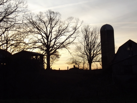 northeast ohio: Rural farm silhouette in Mantua Ohio  Image captured in the early morning just as the sun was rising