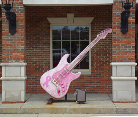 fender stratocaster: Giant pink electric guitar located in Hudson Ohio