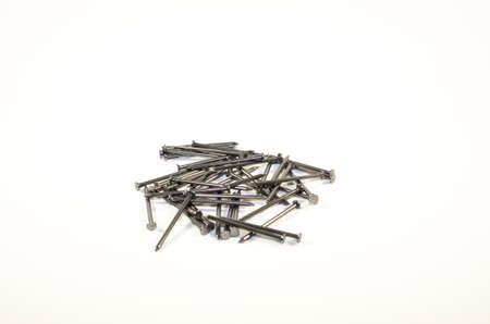 metal fastener: Pile of nails isolated on a white background