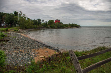 Lighthouse on the shore of Lake Superior at Marquette, Michigan Stock Photo