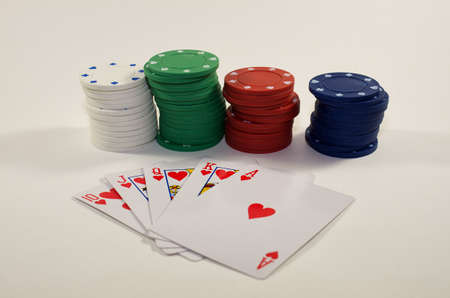 Poker cards and chips isolated on white background