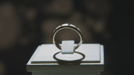 pedant: Precious diamond rings. Fine luxury diamond jewellery window display with ring pedant. Gold ring with brilliant isolated on black background