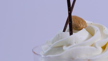 cold: Vanilla sundae ice cream in cup on background. Ice cream in a glass with cream, closeup Stock Photo
