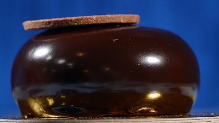 Flourless chocolate cake. Big chocolate sponge cake. Mirror chocolate on the cake.