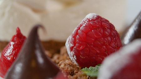 Close up of strawberry and chocolate spread. Chocolate drop and strawberries closeup.