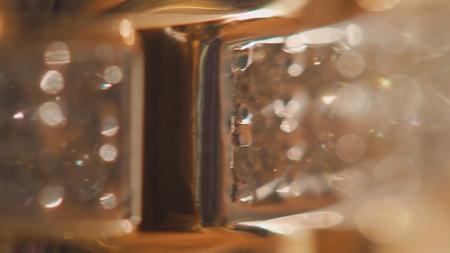 Antique gold bracelet background. abstract background with golden twinkle. String of diamonds on bracelet background 4K