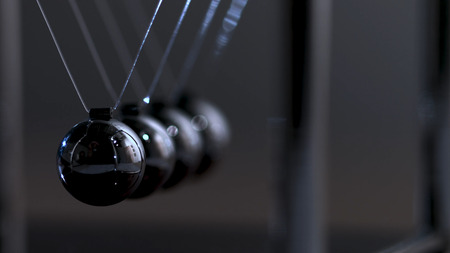 Newtons cradle physics concept for action and reaction or cause and effect. Balls Newton