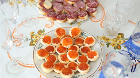 Caviar canape on luxury table. Red Caviar And Fish Strawberries On Table. Wedding