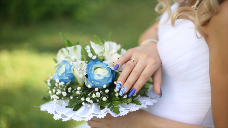 arm bouquet: Beautiful bouquet of different colors in the hands of the bride in a white dress. Bride in white dress with bouquet Black woman holds wedding bouquet. Wedding