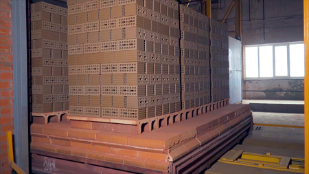 Plant for the production of bricks. Plant for production building material with ready brick, construction industrial. Production of bricks on plant. Workflow, close-up. Brick stacks. Many bricks HD
