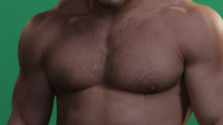 MMA fighter on a green screen. Muscular man on green screen. Green background. Banco de Imagens
