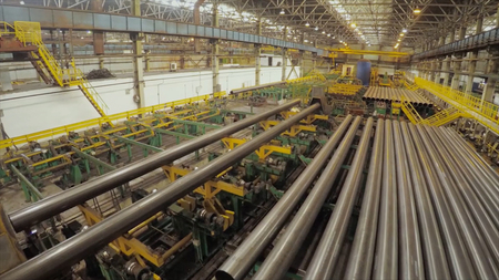 Old factory of auto components production. Warehouse of an aluminum pipes. the production of metal pipes. Pipe welding. Industrial zone, Steel pipelines and equipment. Metal pipes in a warehouse. Stack of new and shiny steel pipe in factory HD
