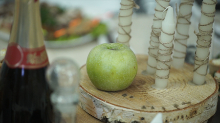 Green apple, cinnamon, walnut and a candle. Green apple and candles. Green apple candle