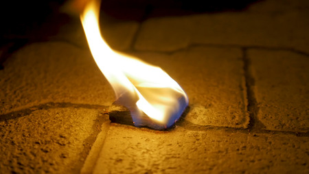 Charcoal fire with wood on cement. Coal of fire on the stone floor Stock Photo