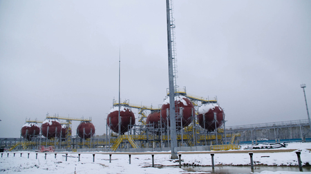 Large Industrial tanks for petrol and oil. Large tanks in the chemical factory. Large tanks for storing fuel are outside Stock Photo