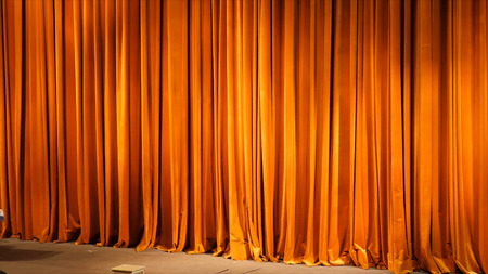The yellow curtain. Theatrical scenes with light from the spotlights in the closed position.