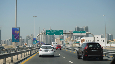 United Arab Emirates, Dubai - October 2017: Man traveling by car in Dubai with a view from the car. View from the interior of the car on the streets of Dubai, cars on a hot day Editorial