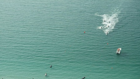People are playing a jet ski in the sea. Aerial view. Jet boats in the ocean