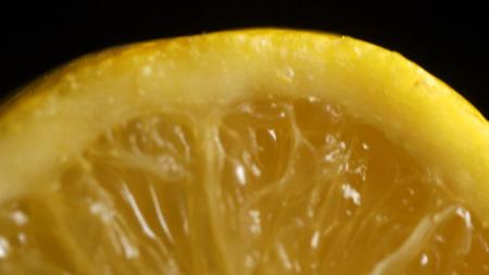 Lemon sectional on black background. Half lemon on a black background. lemon slice on black isolated. Stock Photo