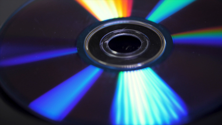 beautiful colored glare from the light, the background disk DVD.