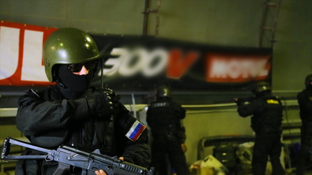 Soldier talking at the radio. Footage. Shot of a soldier holding gun. Masked police special units. Special police commandos arrest a terrorist Stock Photo