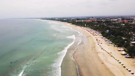 Sea with a white sand beach. Aerial view from above. Sea waves. Sand beach aerial, top view of a beautiful sandy beach aerial shot with the blue waves rolling into the shore. Soft wave of the sea Stock Photo