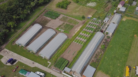 Frameworks of greenhouses, top view. Clip. Construction of greenhouses in the field. Agriculture, agrotechnics of closed ground Stock Photo