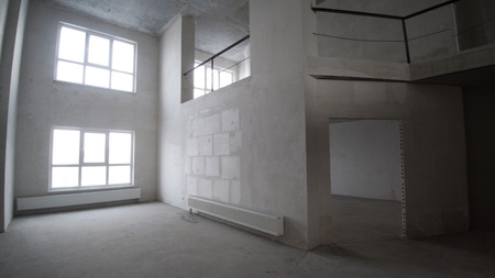 Finishing works at renovated apartment. Clip. Plastered walls, wallpapering, painted ceiling, leveled floor. Electrical wiring installation. Empty light interior. Apartment renovation.