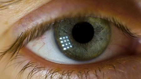Extreme Macro of a brown eye. Video. Closeup of mans eye. spot in the eye. macro. High dynamic range and macro shot hazel eye Stock Photo