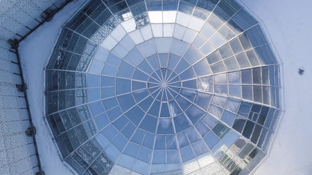 Aerial view on Modern glass building dome. glass dome background. glass roof in building. Top view on Modern radial glass dome of a modern building Stock Photo