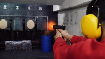 Shoot in dash from pistol. A man shoots a gun in the dash. Stock Photo